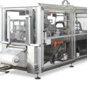 Continuous sleeve shrink wrapping machine